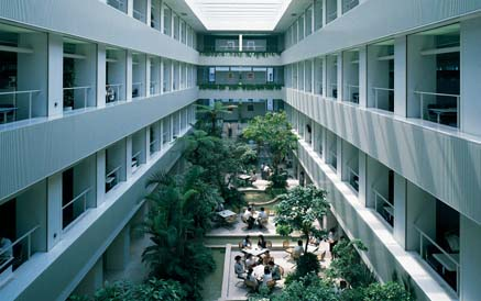 Featuring lush tropical plants, the atrium of the KI Building has not lost any of its ultramodern appeal since the building's completion in 1989.